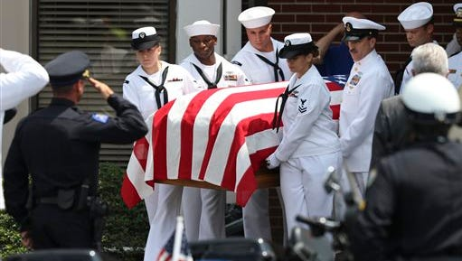 Pallbearers carry the casket of Petty Officer 2nd Class Randall Scott Smith out of the First Baptist Church in Fort Oglethorpe, Ga., before transporting him to the Chattanooga National Cemetery on Tuesday, July 28, 2015. Scott was one of five servicemen whose death was the result of a series of shootings at military facilities in Chattanooga on July 16, 2015.
