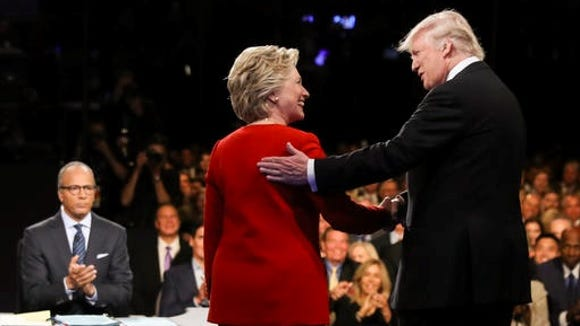 Democratic presidential nominee Hillary Clinton and Republican presidential nominee Donald Trump shake hands during the presidential debate at Hofstra University in Hempstead.