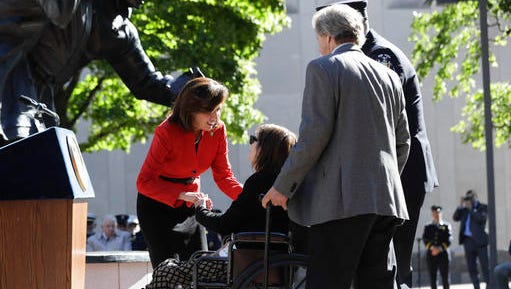 Lt. Gov. Kathy Hochul, left, talks with the family of fallen firefighter Jack Rose during a ceremony at the New York State Fallen Firefighters Memorial on Tuesday in Albany. Rose, a firefighter from the Mt. Marion Fire Department, was one of eight firefighters who died in the line of duty whose name was added to the memorial.