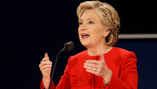 Hillary Clinton answers a question during the presidential debate with Donald Trump at Hofstra University in Hempstead, N.Y.