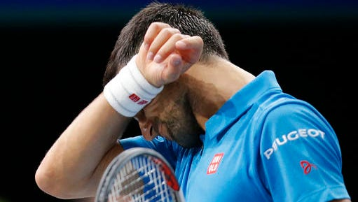 Novak Djokovic of Serbia reacts after loosing a point against Marin Cilic of Croatia during the quarterfinal match of the Paris Masters tennis tournament at the Bercy Arena in Paris, Friday, Nov. 4, 2016. Cilic won 6-4, 7-6.