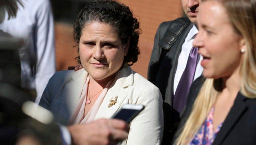 University of Virginia administrator Nicole Eramo, left, listens to attorney Libby Locke, right, speak with the media outside the federal courthouse in Charlottesville, Va., on Friday, Nov. 4, 2016. A federal jury on Friday found Rolling Stone magazine, its publisher and a reporter defamed Eramo in a discredited story about gang rape at a fraternity house of the university.