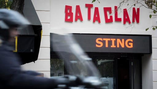 A man rides his scooter in front of the Bataclan concert hall in Paris, France, Saturday, Nov. 12, 2016. A concert by British pop legend Sting is marking the reopening of the Paris' Bataclan concert hall, one year after suicidal jihadis turned it into a bloodbath and killed 90 revelers with automatic weapons and explosive belts. (AP Photo/Kamil Zihnioglu)