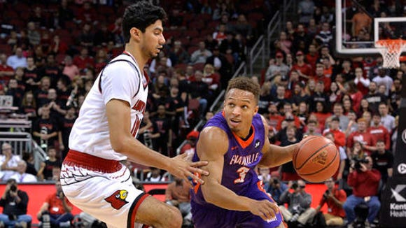 Evansville's Jaylon Brown (3) tries to drive around the defense of Louisville's Anas Mahmoud (14) during the first half of an NCAA college basketball game, Friday, Nov. 11, 2016, in Louisville Ky.
