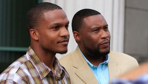 CORRECTS LEFT TO RIGHT TO IDENTIFY BRANDON DUNCAN AT RIGHT - In this March 16, 2015, photo, San Diego-based rapper Brandon Duncan, right, and Aaron Harvey hold a press conference after a trial in San Diego, Calif. Duncan and Harvey, a community organizer, sued the city of San Diego on Tuesday, Jan. 10, 2017, for federal civil rights violations over being jailed on gang-related charges that were based on their rap lyrics and social media postings.