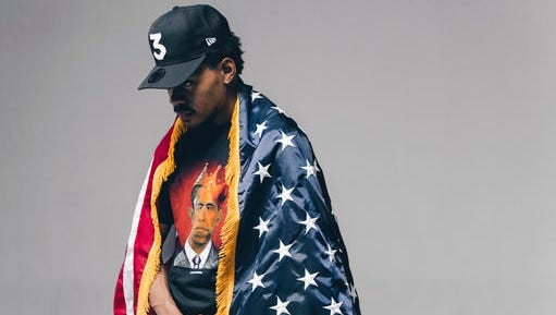 "This undated image released by Nolis Anderson shows Chance the rapper draped in an American flag and wearing Obama-themed clothing made by Joe Fresh Goods' ""Thank You Obama"" line."