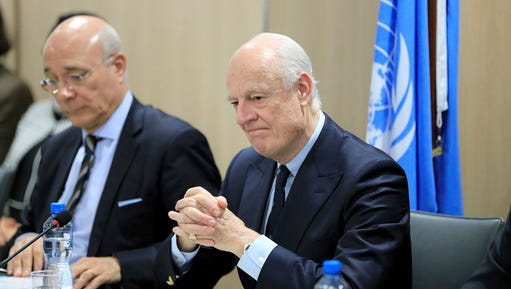 UN Special Envoy for Syria Staffan de Mistura, right, attends a meeting of Intra-Syria peace talks with Syrian government delegation at Palais des Nations in Geneva, Switzerland, Saturday, Feb. 25, 2017.