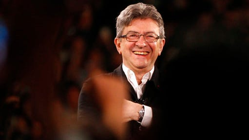 French Left party leader and candidate for the 2017 French presidential election, Jean-Luc Melenchon delivers a speech during a meeting in Lille, northern France, Wednesday, April 12, 2017.