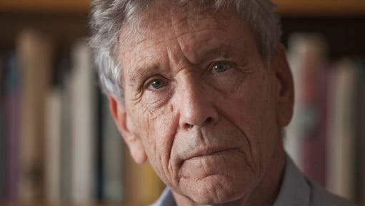 "FILE - A Wednesday, Nov. 4, 2015 file photo of Israeli writer Amos Oz at his house in Tel Aviv. Two of Israel's most renowned authors and an Argentine first-time novelist are among six finalists for the Man Booker International Prize for fiction. David Grossman's ""A Horse Walks Into a Bar,"" Amos Oz's ""Judas"" and Samanta Schweblin's ""Fever Dream"" are on a six-book shortlist announced Thursday, April 20, 2017, for the 50,000 pound ($64,000) prize."