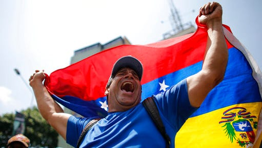 A man shouts anti-government slogans during a protest in Caracas, Venezuela, Thursday, April 20, 2017. Venezuela's opposition is calling for another day of protests against President Maduro after mass demonstrations Wednesday resulted in two deaths.