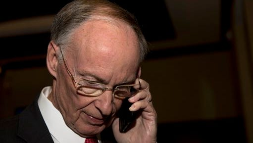 Republican Gov. Robert Bentley takes the phone call announcing his win for Alabama governor, Tuesday, Nov. 4, 2014, in Montgomery, Ala. Bentley defeated his opponent Democrat Parker Griffith. (AP Photo/Brynn Anderson)