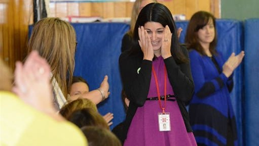 Fourth-grade teacher Roseann Maurantonio is surprised during an assembly where it was announced that she was a winner of a 2014 Milken Educator Award and $25,000, Wednesday, Nov. 12, 2014, at Rosendale Elementary School in Niskayuna, N.Y. (AP Photo/The Daily Gazette, Patrick Dodson)  TROY, SCHENECTADY; SARATOGA SPRINGS; ALBANY AND AMSTERDAM OUT