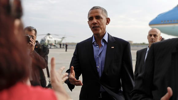 President Obama greets people on the tarmac as he arrives