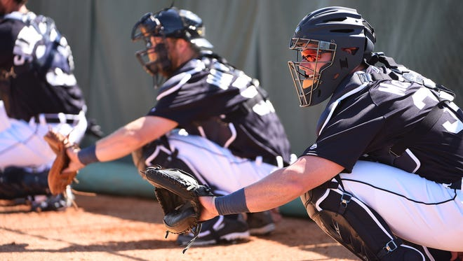 James McCann catches Tiger pitchers in bullpen sessions Friday.
