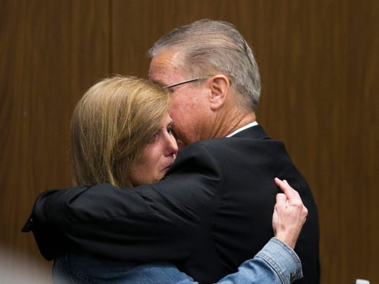 Scott Farmer hugs his wife, Jackie, after announcing