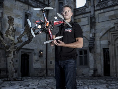 Manie Kohn, 43, founder and CEO of Don't Tell Me Show Me, with his RC Quadcopter at a home in Hillsborough, Calif.