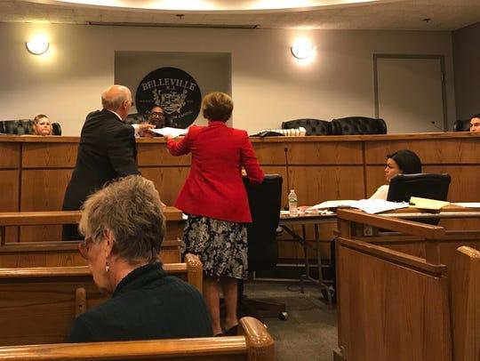 Attorney for the defense Gina Calogero, right, enters