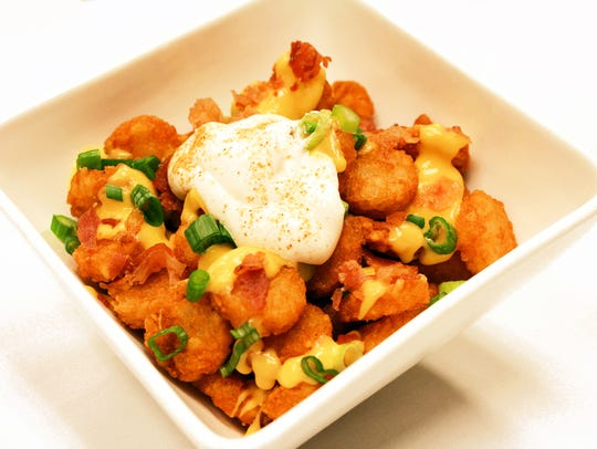 These tater tots smothered in cheddar cheese sauce,
