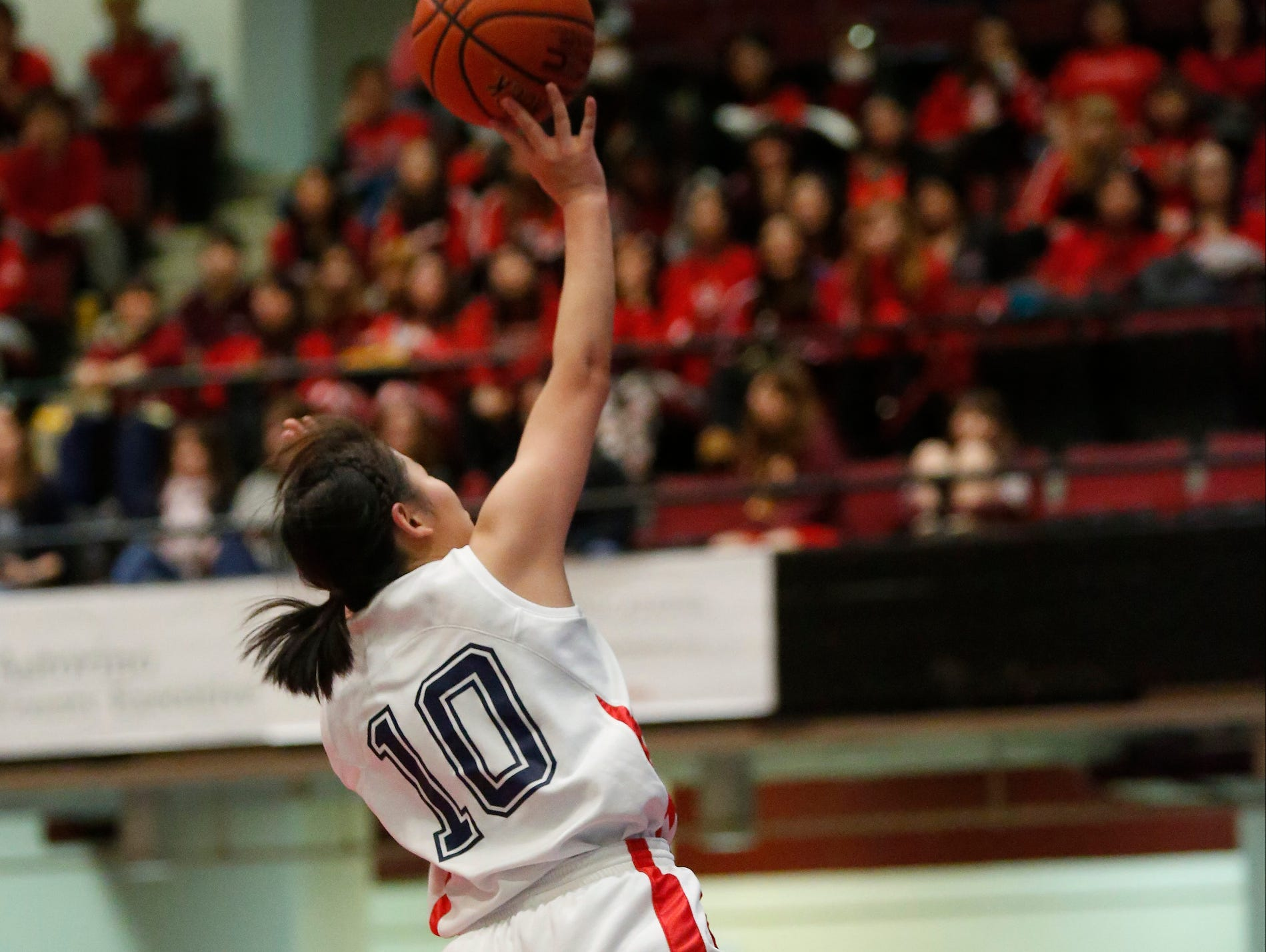 Keio's Ayano Miyauchi (10) puts up a shot after a fast break against North Salem in the class C semi-final basketball game at the Westchester County Center in White Plains on Saturday, February 27, 2016.