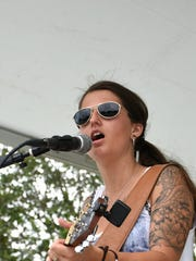 Country music performer Sheena Brook entertains at the Sugden Park event.