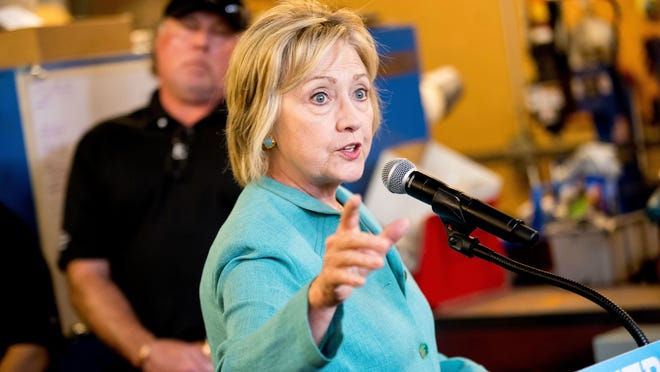 Democratic presidential candidate Hillary Clinton responds to a reporters question after taking a tour of Mojave Electric Company in Las Vegas, Thursday, Aug. 4, 2016. (AP Photo/Andrew Harnik)