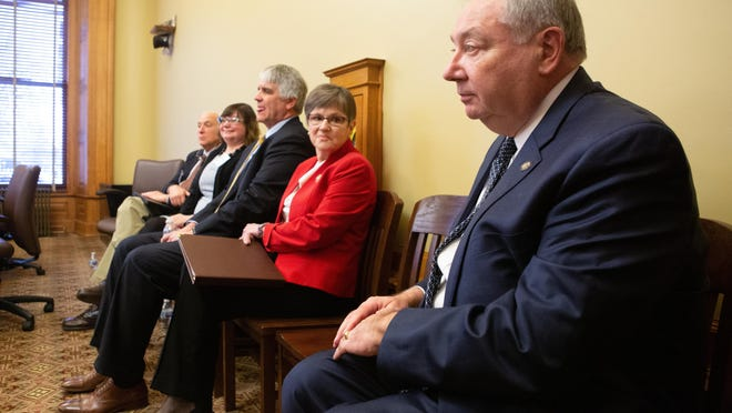 Sen. Jim Denning, right, and Gov. Laura Kelly, second from right, got into tense moments during the State Finance Council meeting on Friday.