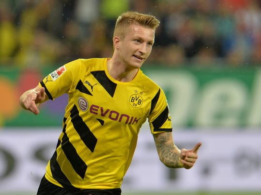 Dortmund's Marco Reus celebrates after scoring during the  soccer match between FC Augsburg and Borussia Dortmund in the SLG Arena in Augsburg, Germany, on Friday, Aug. 29, 2014. (AP Photo/Kerstin Joensson)