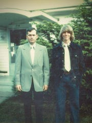 Michael Peterson, right, with his adoptive father,