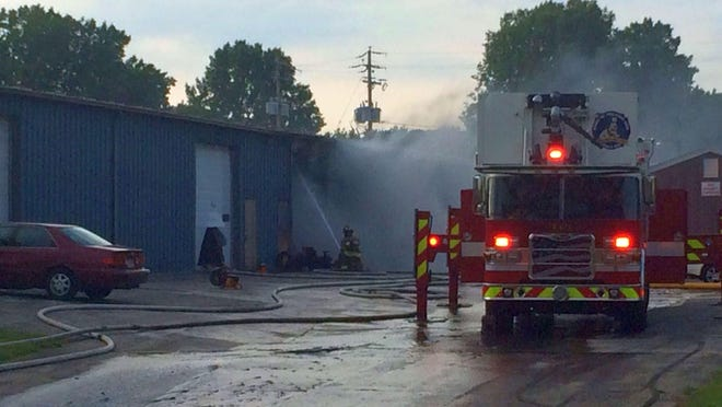 Crews from the Green Bay Metro Fire Department fight a fire at a warehouse at 1919 Cofrin Drive in Green Bay on Thursday night.