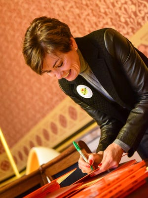 "Lt. Governor Kim Reynolds autographs copies of ""Green Eggs & Ham"" on Wednesday, March 2, 2016, during Iowa Egg Council's reading with Capitol View Elementary at the State Capitol."
