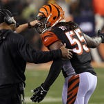 Cincinnati Bengals outside linebacker Vontaze Burfict (55) talks with Cincinnati Bengals head coach Marvin Lewis during the fourth quarter against the Pittsburgh Steelers in the AFC Wild Card playoff football game at Paul Brown Stadium.