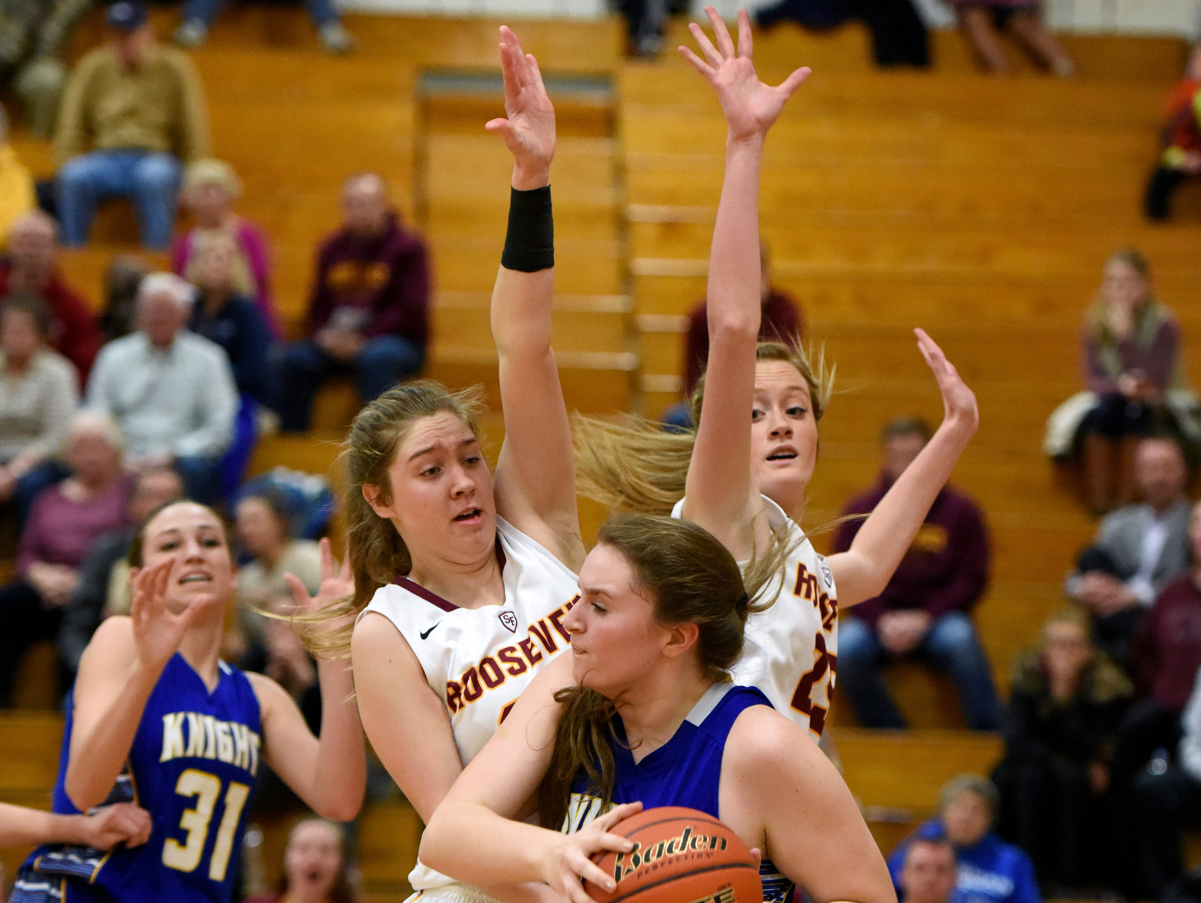 O'Gorman's Courtney Baruth looks to pass around Roosevelt's Katie Johnson (33) and Tahia Mitzel (23) during their game Thursday at Roosevelt High School.