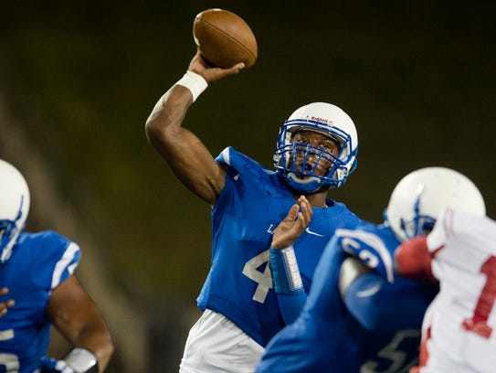 Lanier James Foster throws a pass during the game on