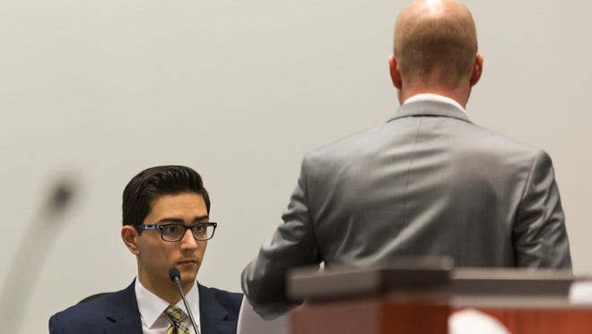 Steven Jones (left) looks at evidence presented by deputy county attorney Ammon Barker  on  April 20, 2017. Barker questioned Jones' eyesight during the trial.