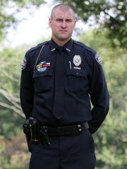 Lt. Mark Elliott stands with his K-9, Lt. Six, after