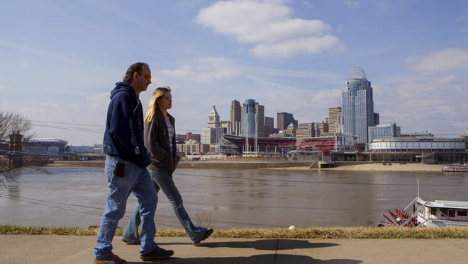A couple walks along the Newport riverfront last year. A developer wants to build a residential and commercial development on Newport's riverfront where Hooter's operates now.