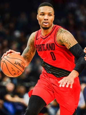 Portland Trail Blazers guard Damian Lillard (0) controls the ball against the Minnesota Timberwolves during the second half at Target Center.