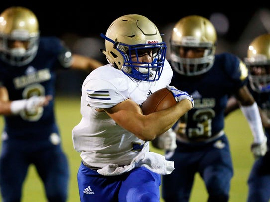 Independence's Grant Yocam outruns the Brentwood defense