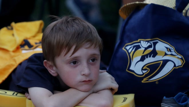 Cody Campbell watches as the Jets go up 2-0 in the first period during the watch party for game 7 of the playoff series between the Predators and Jets Thursday May 10, 2018.