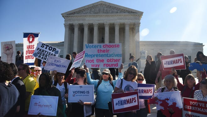 Demonstrators gather outside the Supreme Court during oral arguments in Gill v. Whitford to call for an end to partisan gerrymandering in Washington, Oct. 3, 2017.
