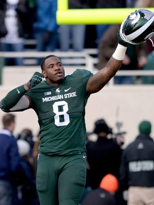 Defensive end Lawrence Thomas (8) goes out onto the field during Senior Day festivities before MSU's 55-16 win over Penn State Saturday, Nov. 28,at Spartan Stadium in East Lansing.