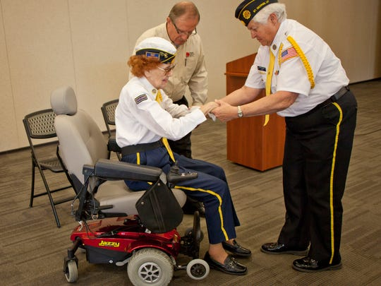 Representatives from Dealer Collision Center and the Southern Utah Veteran Home, along with fellow American Legion Post 90 members, recognize World War II Veteran Audre Wells Wednesday, April 1, 2015.