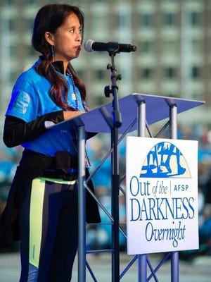 Raela speaks at opening ceremony for her 10th Overnight Walk in Boston in June.