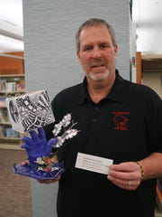 "Sen. Rick Gudex chose ""Elements of Art Hand"" by McKenzie G. from Merrill Middle."