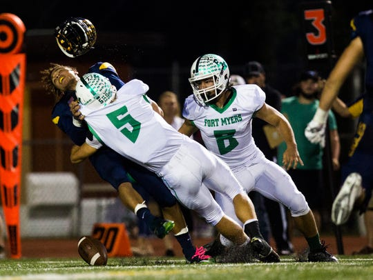 Naples High quarterback Jordan Persad-Tirone is drilled by the Fort Myers defense in a 2016 playoff game. Persad-Tirone, who had five turnovers in the loss, said his performance -- and this picture in particular -- motivated him this season.
