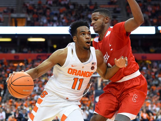 Syracuse forward Oshae Brissett drives to the basket against Cornell forward Steven Julian during the first half at the Carrier Dome on Nov. 10, 2017.