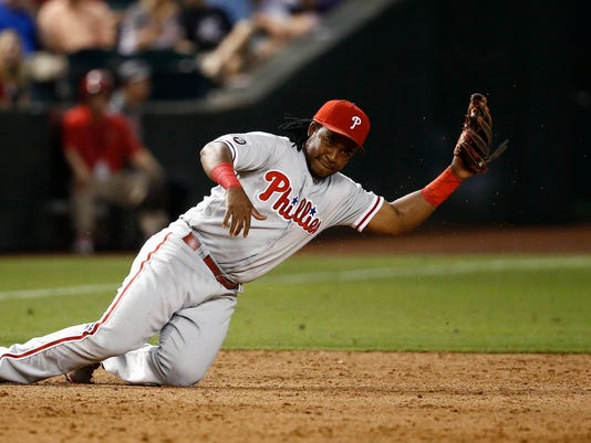 Philadelphia Phillies' Maikel Franco is unable to make a play on a ground ball hit by Arizona Diamondbacks' Brandon Drury during the fifth inning of a baseball game Friday, June 23, 2017, in Phoenix. Drury got a single on the play. (AP Photo/Ross D. Franklin)
