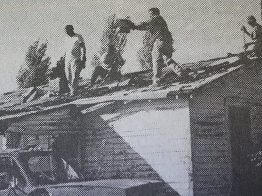 A Fix-It Friday crew, headed by Billy House, center, worked to put a new roof on this house in Sturgis during the county-wide project on a Friday in 2000.