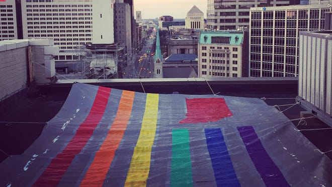 Independent designer and street artist Graham Brown, owner of United State of Indiana, made waves on social media this week with this giant illicit rainbow flag.