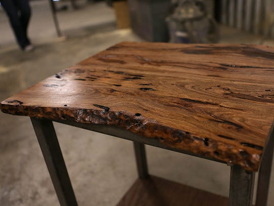 Matching mesquite end tables are being built by Irion